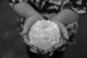 Maria Natividad Garay holds a hailstone she recovered outside her home in Villa Carlos Paz, Argentina. Mitch Dobrowner for The New York Times